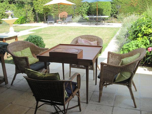 Step out of the terrace into the formal garden at Manoir de Gourin