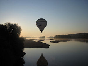 Hot air balloon over Loire Valley at daybreak