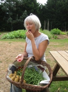 Karin Grainger with basket of home grown veggies